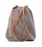 Grey drawstring pouch with brown ribbon Royalty Free Stock Photo