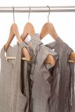 Grey dresses are on hangers. Grey dresses are on wooden hangers royalty free stock photo