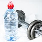 Grey dumbbell and water bottlle stock image