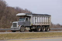Grey Dump Truck. On Highway Royalty Free Stock Images