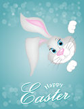 Grey Easter bunny looking out a blue background Royalty Free Stock Photos