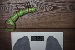 Electronic scales on the wooden floor dieting Royalty Free Stock Images
