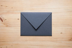 A grey envelope on the wood desk, Royalty Free Stock Image