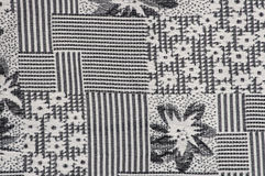 Grey fabric background with flower pattern close-up Royalty Free Stock Image