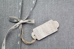Grey fabric background with ribbon. And tag Royalty Free Stock Photos