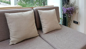 Grey fabric upholstery sofa and cushion Stock Images
