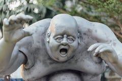 Grey Fat Guy Sculpture exterior fotografia de stock royalty free