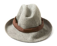 Grey felt fedora with brown hatband. Grey felt fedora hat with brown hatband isolated on white background Royalty Free Stock Images