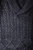 Grey figured sweater background vertical Royalty Free Stock Image