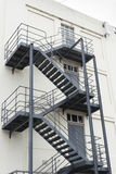 Grey fire escape on white building Royalty Free Stock Photography