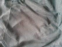 Grey fishnet fabric background Stock Photo