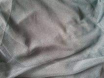 Grey fishnet fabric background Royalty Free Stock Images