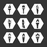 Grey flat torch with flame icons set. Monochrome torch icons collection. Vector illustration Stock Photos