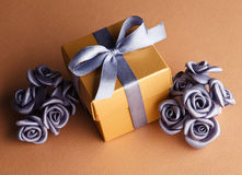 Grey flowers and golden gift box Royalty Free Stock Image