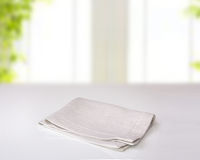 Grey folded kitchen cloth on table indoor. Stock Images