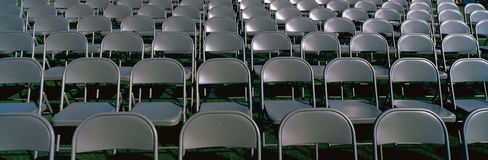 Grey folding chairs awaiting the crowd Royalty Free Stock Images