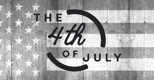 Grey fourth of July graphic against grey american flag on wood panel. Digital composite of Grey fourth of July graphic against grey american flag on wood panel Stock Photography