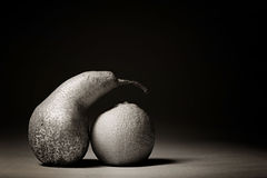 Grey fruits on a black background Royalty Free Stock Photos