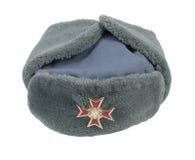 Grey Fur Cap Cross Pin Stock Image