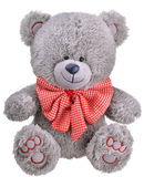Grey furry teddy bear with red bow. Isolated on white background Royalty Free Stock Images