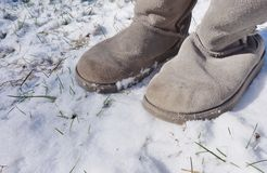 Grey fuzzy boots in the winter snow Stock Photography
