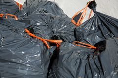 Grey garden rubbish sacks. Royalty Free Stock Photos