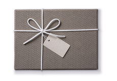 Grey gift box with a tag Royalty Free Stock Photos