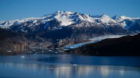 Grey Glacier and lake with snowy mountains on the Torres del Paine hike in Patagonia / Chile. Stock Photos