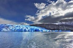 Grey glacier moves down Royalty Free Stock Photos