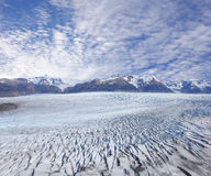 Grey glacier at sunset. Stock Photos