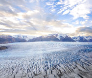 Grey glacier at sunset. Royalty Free Stock Photo