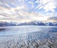 Grey glacier at sunset. Royalty Free Stock Photo