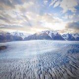 Grey glacier at sunset. Royalty Free Stock Photos
