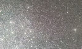 Grey glitter textured background,Bright beautiful shining grey glitter. stock photo