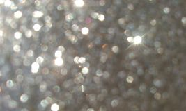 Grey glitter textured background,Bright beautiful shining grey glitter. stock images
