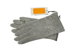 Grey gloves with a price tag. Pair of grey woolen gloves with a blank white-orange price tag bee it, on white background Royalty Free Stock Photos