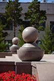 Grey granite balls with pedestals as decoration Royalty Free Stock Photo