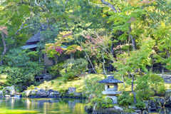 Grey granite lantern in Japanese garden in fall Royalty Free Stock Photos