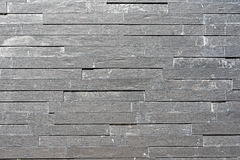 Grey granite tiled wall Stock Images