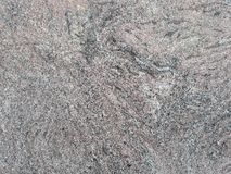 Grey granite with veins texture. May be used as background Stock Images
