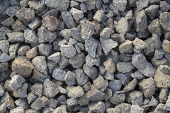 Grey gravel closeup photo for background. Sharp gray stones in pile for construction. Royalty Free Stock Photo