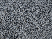Grey gravel texture - granite stone background. Grit Royalty Free Stock Photography