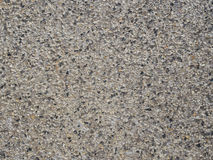 The grey gravel textured plaster close up. Stock Photo