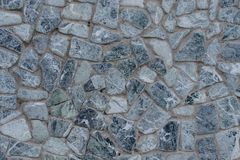 Grey gray detailed stone close up beautiful with concrete wall stone texture of modern house. White and black blue hue color. Grey. Gray detailed stone close up stock image