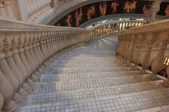 Grey greek mosaic stairs with marble column and traditional pictures. Ancient architecture background. Building detail. Empty staircase. Staircase perspective royalty free stock photos