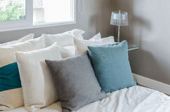 Grey and green pillow on white bed in modern bedroom Royalty Free Stock Photo