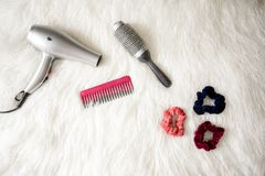 Grey Hair Blower Near Pink Hair Combs and Scrunchies Stock Photography