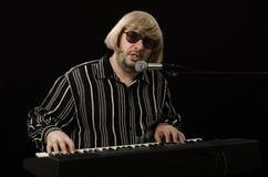 Grey haired bearded singer Stock Images