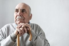 Grey haired elderly man with mustache thinking royalty free stock photos