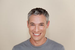 Grey-haired man smiling Stock Image